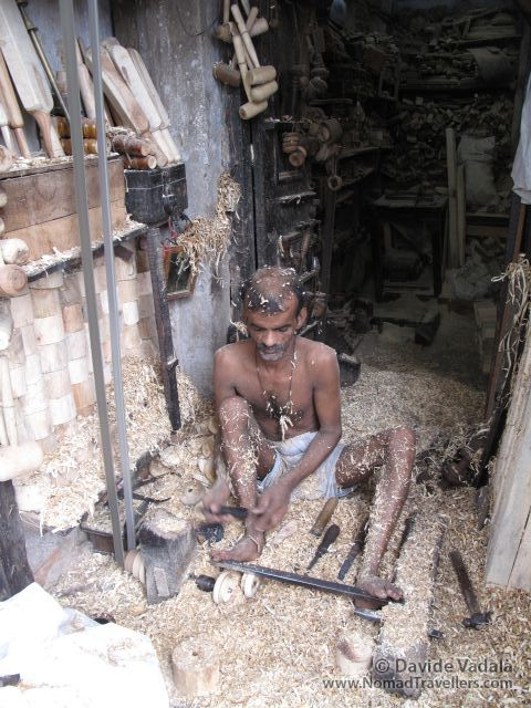 An ironer inside Auroville community, Tamil Nadu, barefoot and still