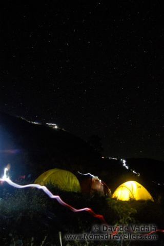 Caming on Mount Rinjani: on the background a line of flashlights