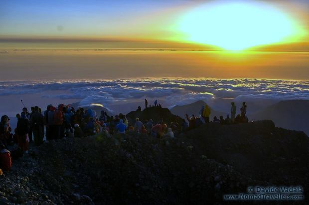 Plenty of climbers to admire the sun rising over the clouds