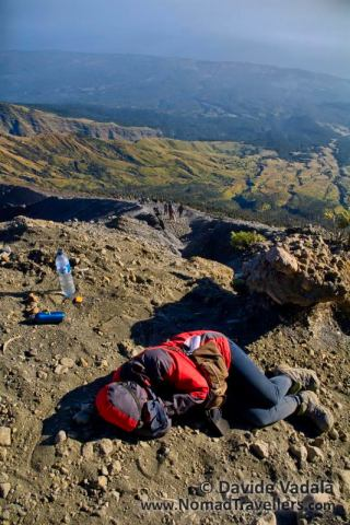 An hiker sleeps on the ashes of Rinjani volcano