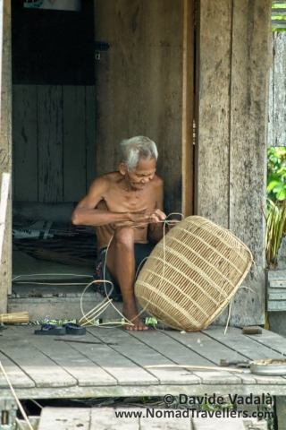 A man working on a fishing device in Sekonyer village
