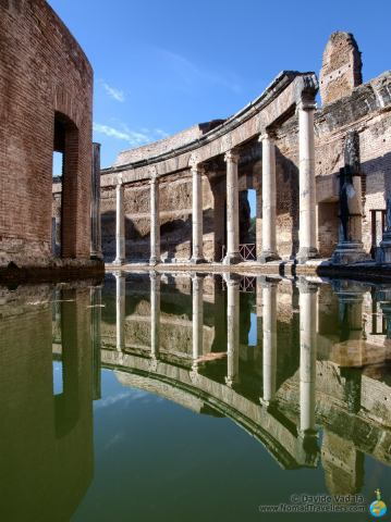 Classical orders reflecting in the water of the Maritime Theater