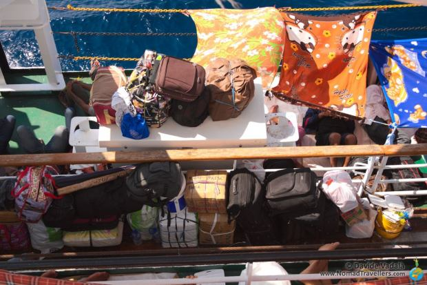 Backpacks, suitcases and boxes piled on the edge of the boat