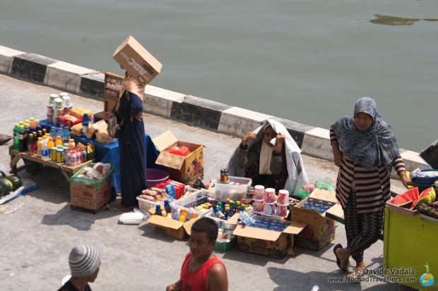A temporary market below the ferry showing a picturesque society