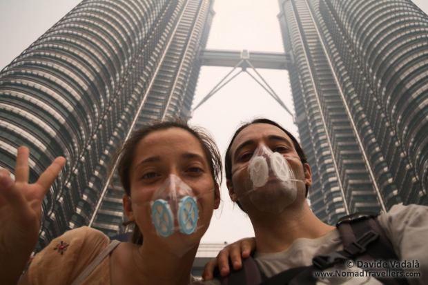 Davide and Oti with Totobobo masks in front of the Petronas towers