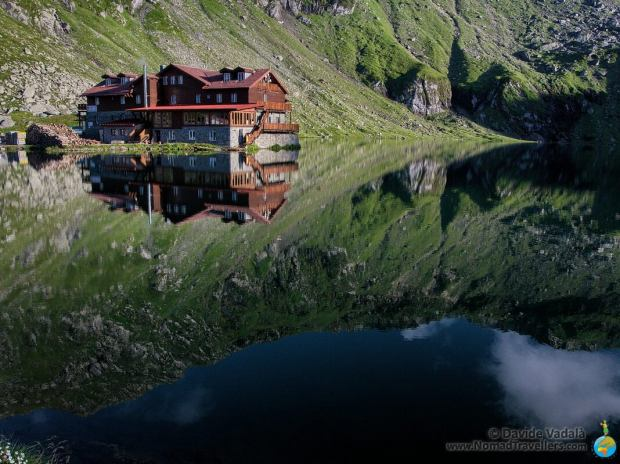 One of the mountain huts reflected on the Lake of Balea