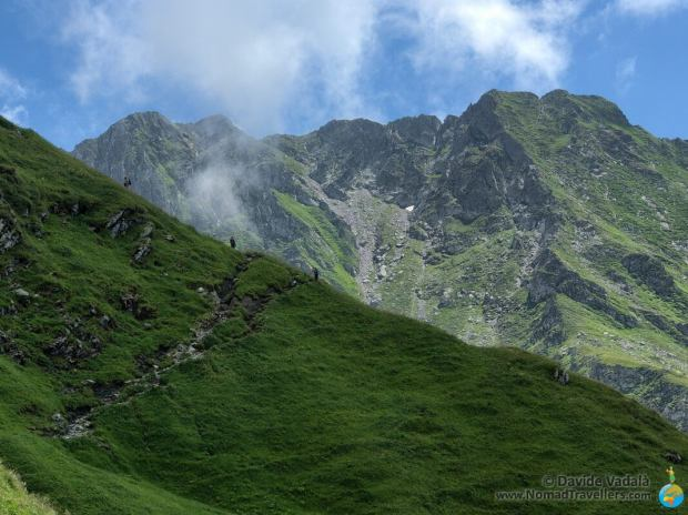 Sharp peaks on the Fagaras mountains appear while hiking